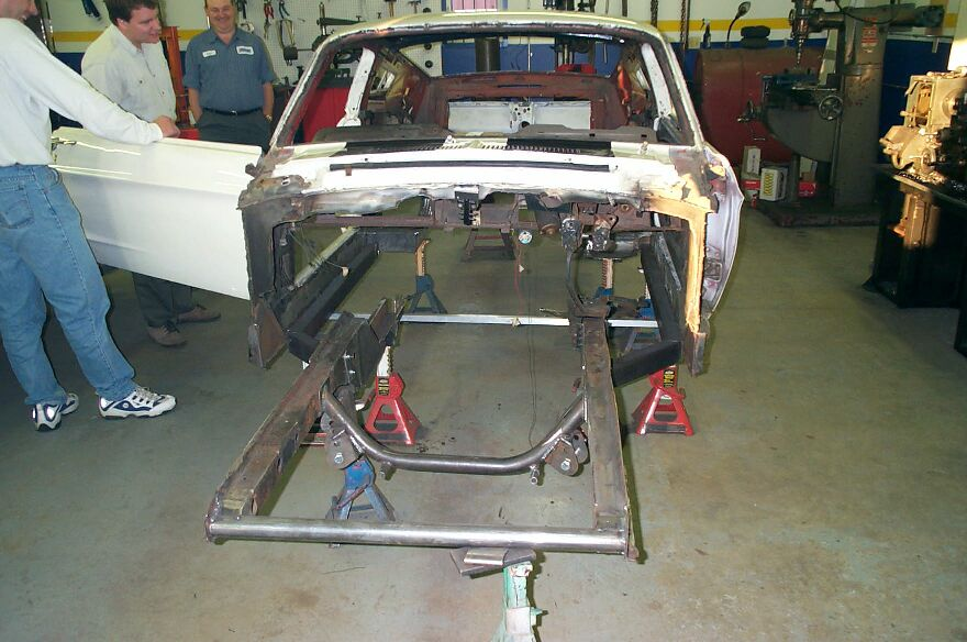 frame rails were added to connect the rear to the front we have decided to run a full tube frame race car