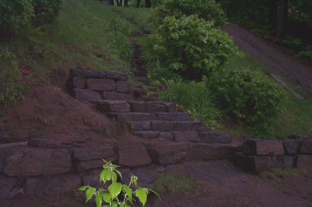 Large Stone Retaining Wall And Staircase